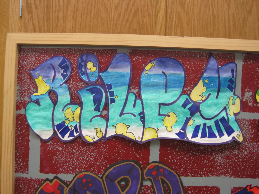 Once the graffiti was finished the words were cut out with x acto knives and posted on our brick wall for display